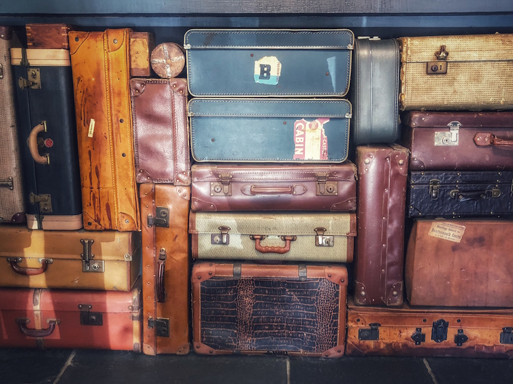 Essential Pack List Blog Travel Suitcases Image