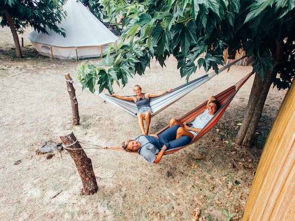 Girls Chilling in Hammock in Surf Camp in France | 600x450